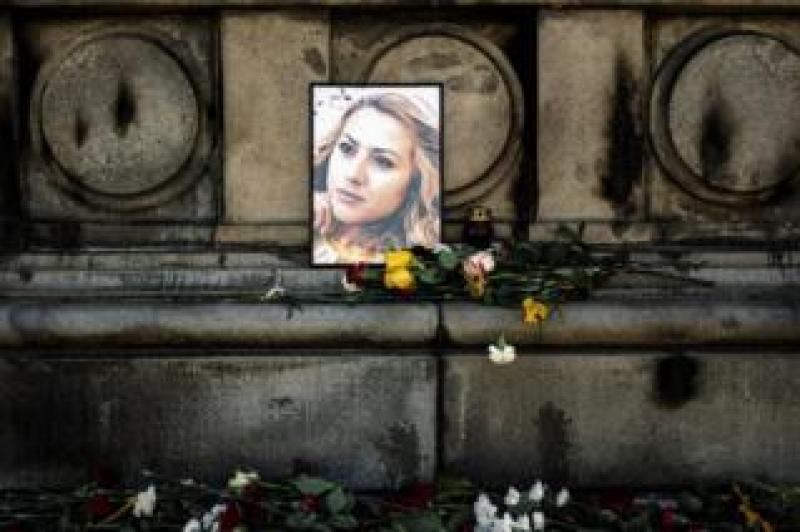 Flowers are placed near a portrait of slain Bulgarian television journalist Viktoria Marinova in the city of Ruse on 9 October 2018.