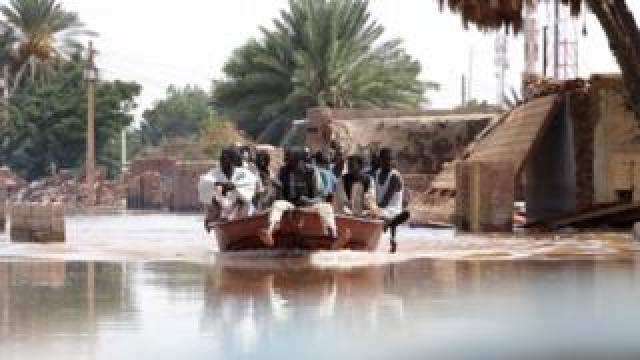 Sudanese return to look for household items to salvage following heaving floods in Wad Ramli, some 45 km north of Khartoum, Sudan, 25 August 2019.