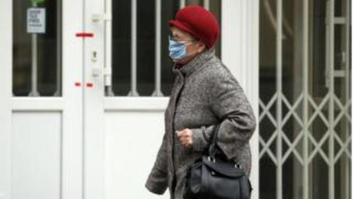 A woman wearing a muzzle