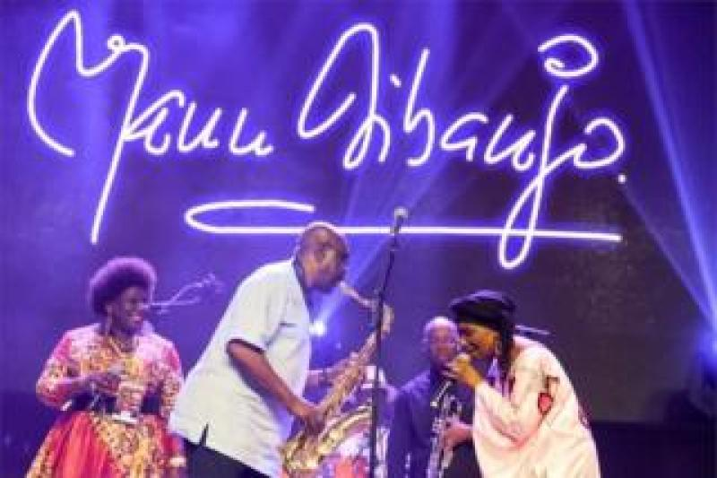 """Manu Dibango, saxophonist and Franco-Cameroonian singer of world jazz, performs during his concert on June 29, 2018 at the Ivory Hotel Abidjan. Saxophonist Manu Dibango, who plays """"Baobab"""" African music, celebrates his 60 years of music, giving a unique concert in Abidjan, following his successful return to the Ivory Coast where he used to play in the 1970s"""