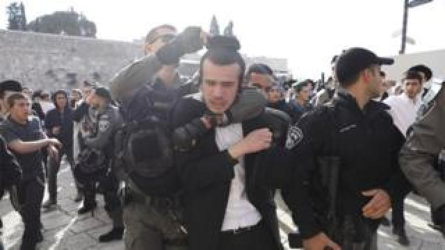 "Israeli border police scuffle with ultra-Orthodox Jews protesting against members of the ""Women of the Wall"" feminist organization gathering inside the women's section of the Western Wall in Jerusalem's Old City, 8 March 2019"