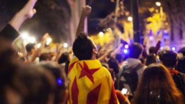 A protester shouting outside the Catalan justice court., during a demonstration in Barcelona