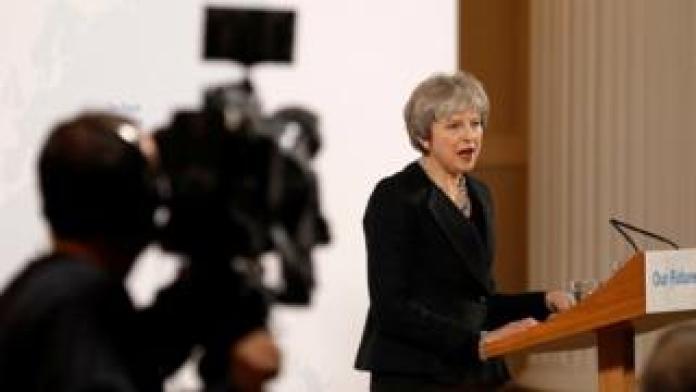 Theresa May and a cameraman