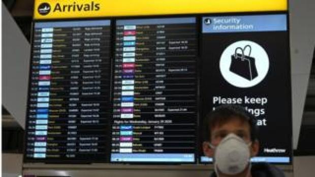 Man wearing mask at Heathrow