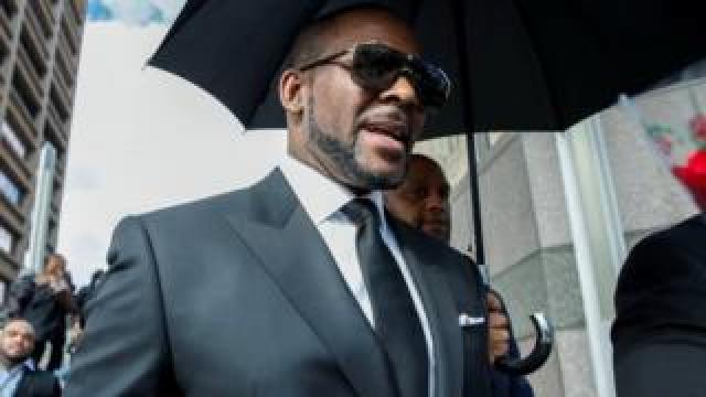 R. Kelly walking to court