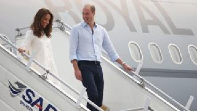 Duke and Duchess of Cambridge walk down the steps of a plane as they arrive in Lahore on 17 October 2019