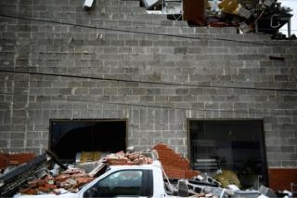 NEWS A truck is seen below a partial collapsed wall after Hurricane Michael in Panama City, Florida, 10 October 2018