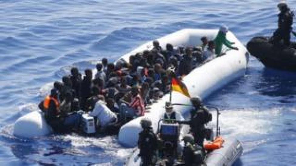 German Navy sailors ad Finish special forces surround a boat with migrants off the coast of Libya. Photo: March 2016