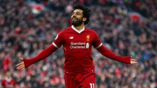 Mo Salah celebrates a goal with his arms out wide