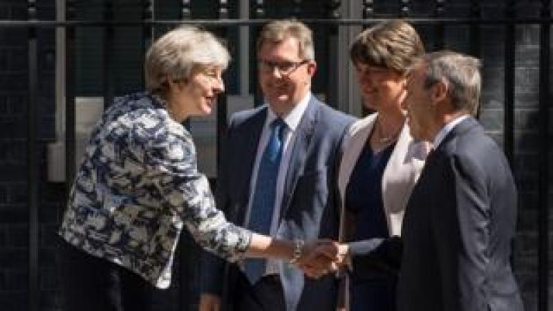 Theresa May greets Arlene Foster and other DUP figures in Downing Street