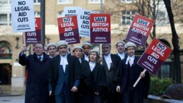 British legal professionals protest against legal cuts