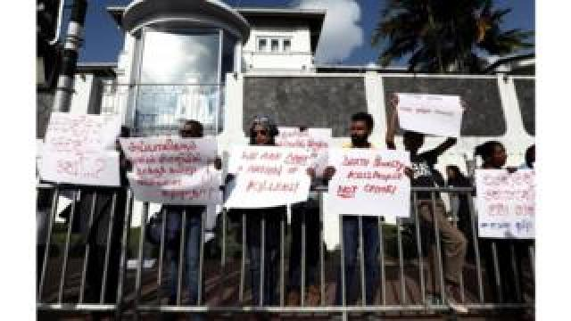 Protesters holding placards condemning the return of capital punishment outside the Welikada prison on Friday 28 June