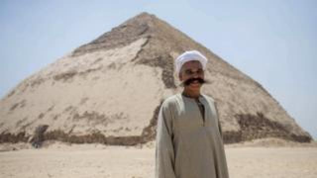 A man stands in front of the Bent Pyramid, Egypt. Photo: 13 July 2019