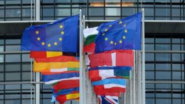 Flags outside the European Parliament