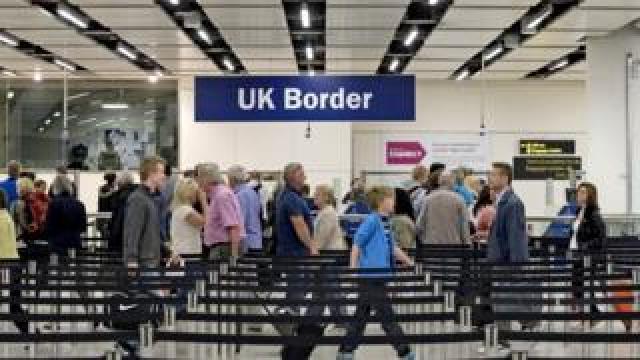 Passport checks at the UK border in Gatwick Airport