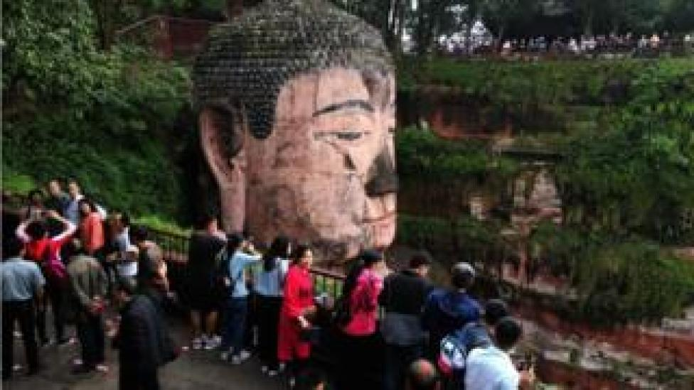 Tourists visit the Leshan Buddha in Sichuan province