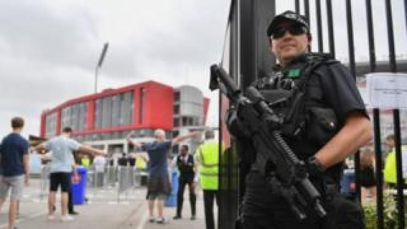 Armed officer at Manchester's Old Trafford cricket ground
