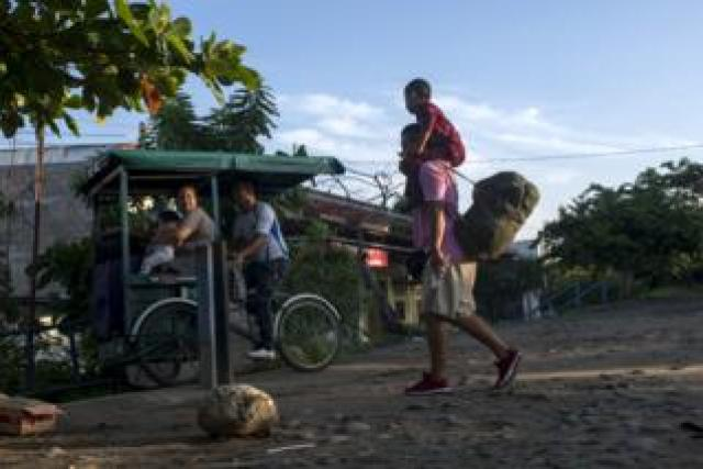 Migrants take a bicycle in southern Mexico