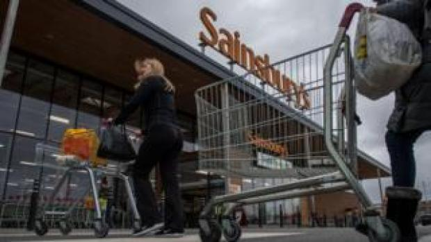 People walk into Sainsbury's store