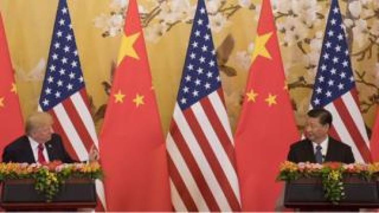 US President Donald Trump and Chinese President Xi Jinping speak during a joint statement in Beijing on November 9, 2017.