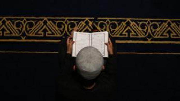 A boy reading the Koran - Sunday 12 May