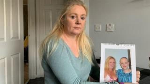 Michelle Hughes with a photograph of her sister