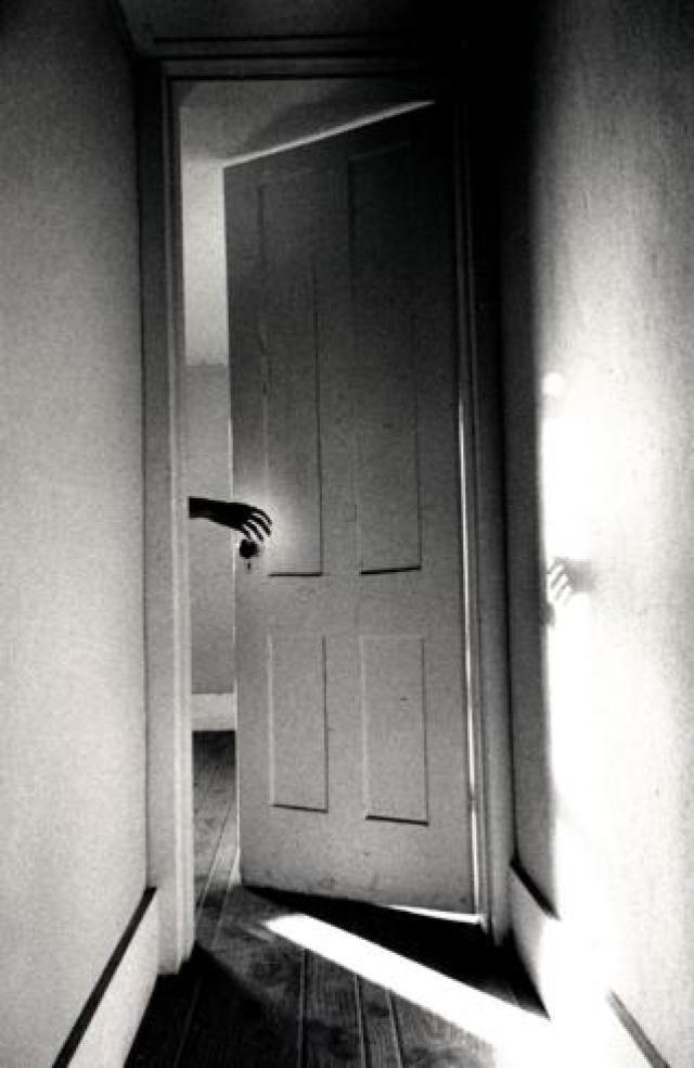 Hand in a doorway