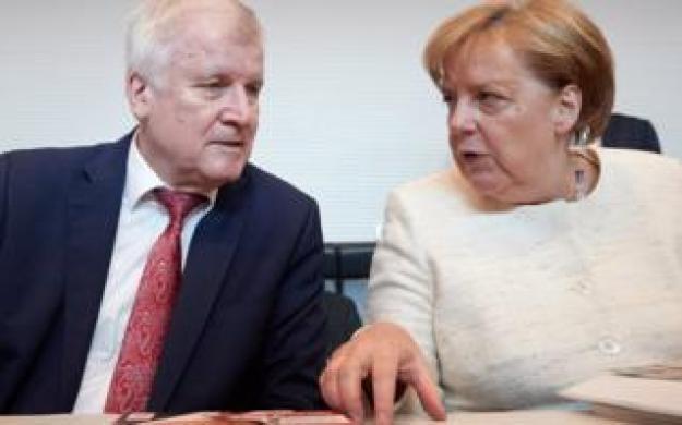 Horst Seehofer with German Chancellor Angela Merkel, 12 Jun 18