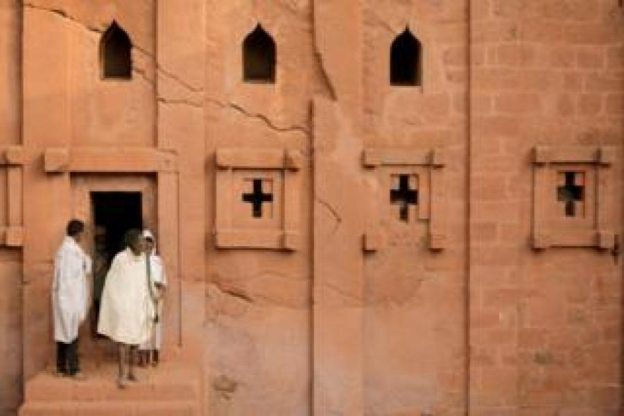 Ethiopian Orthodox pilgrims leave after attending a morning prayer session at the Bete Amanuel,