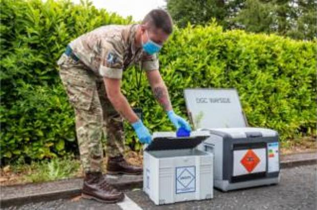Soldier at mobile testing unit