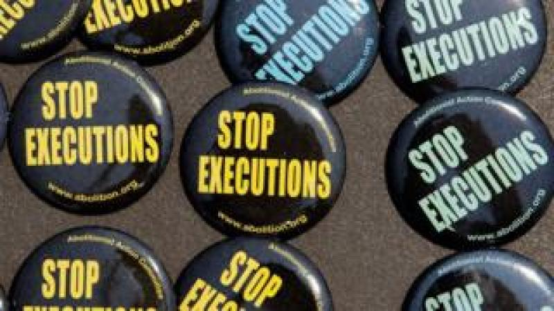 Buttons were for sale as death penalty opponents mark the 40th anniversary of the Supreme Court's landmark Furman v. Georgia decision outside the court
