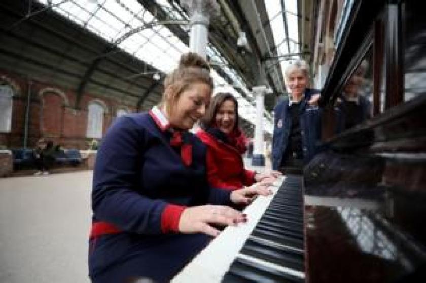 Malcolm Ingram, Sam Gilmoura and Brigid McElroy at the Darlington piano