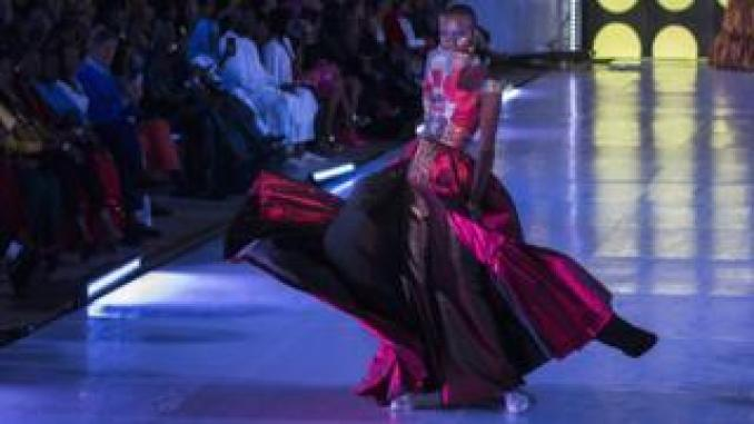 Senegalese model Alima Diop poses on the catwalk wearing a design by Algaye during Dakar Fashion Week in Dakar, Senegal