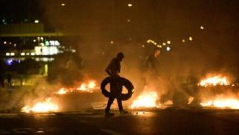 Demonstrators burn tyres as protesters riot in the Rosengard neighbourhood of Malmo, Sweden, on 28 August 2020.