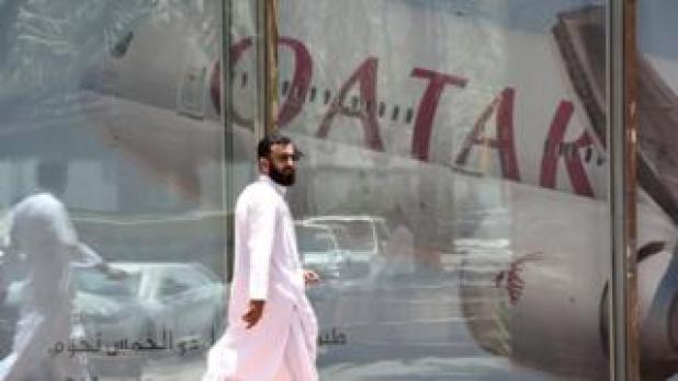 A man walks past the Qatar Airways branch in the Saudi capital Riyadh. Photo: June 2016
