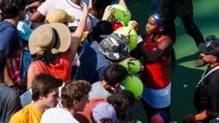 Coco-Gauff-surrounded-by-fans.
