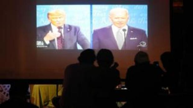 People in a Miami bar watch Donald Trump and Joe Biden participate in their first 2020 presidential campaign debate