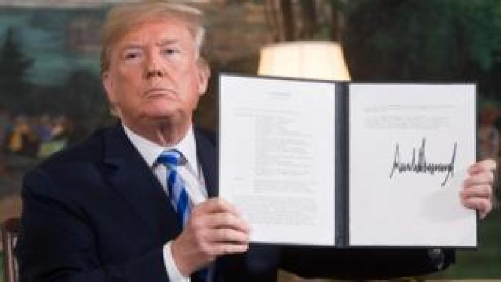Donald Trump signs a document reaffirming the sanctions