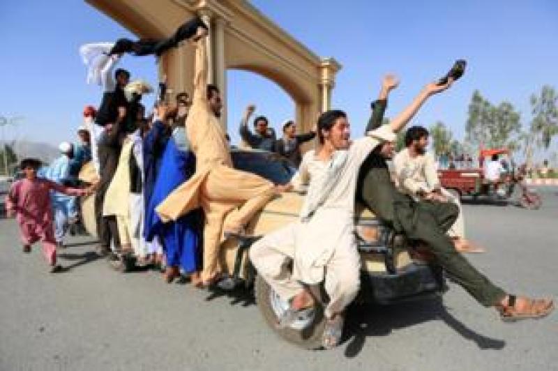 People celebrate ceasefire in Rodat district of Nangarhar province, Afghanistan, 16 June 2018.