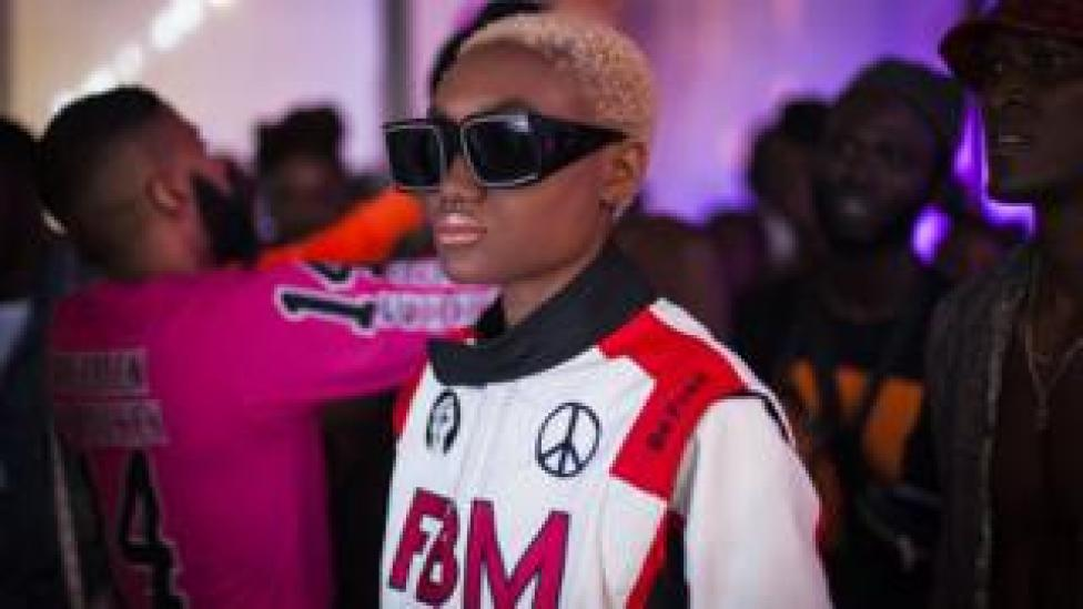 A model backstage in bomber jacked and sunglasses during Dakar Fashion Week in Dakar, Senegal