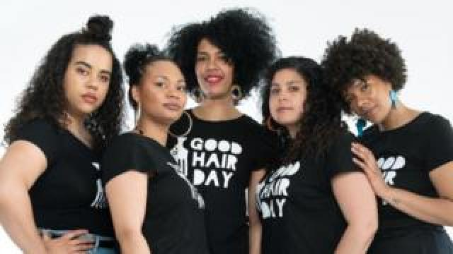 Five women with afro hair