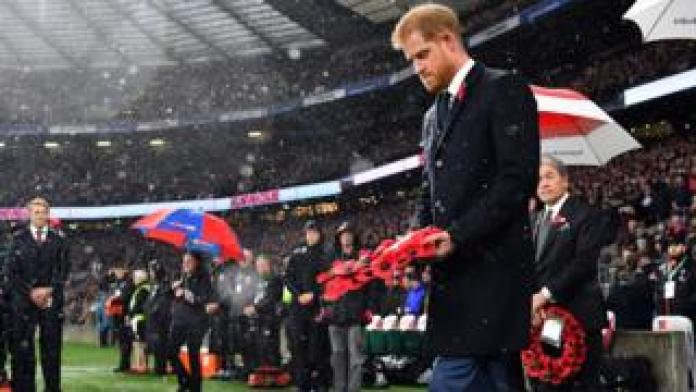 Duke of Sussex walks to a wreath on the pitch of the autumn international rugby union match between England and New Zealand at Twickenham Stadium