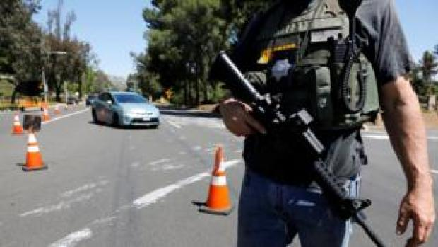 A San Diego County Sheriff's Deputy secures the scene of a shooting incident at the Congregation Chabad synagogue in Poway, north of San Diego, California, U.S. April 27, 2019