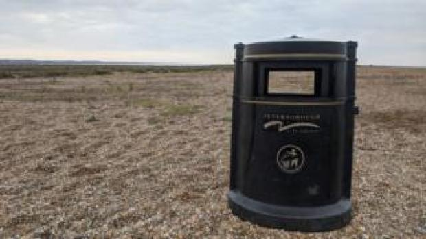 A bin on a beach