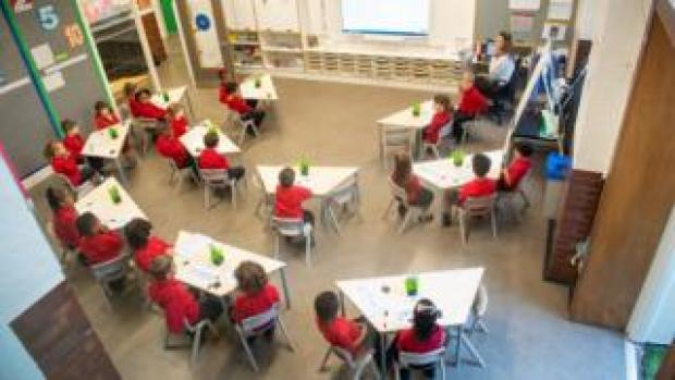 Pupils on their first day back to school at Charles Dickens Primary School, in London