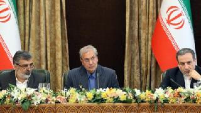 Behrouz Kamalvandi, left, Ali Rabiei, centre, and Abbas Araqchi, right, address the press