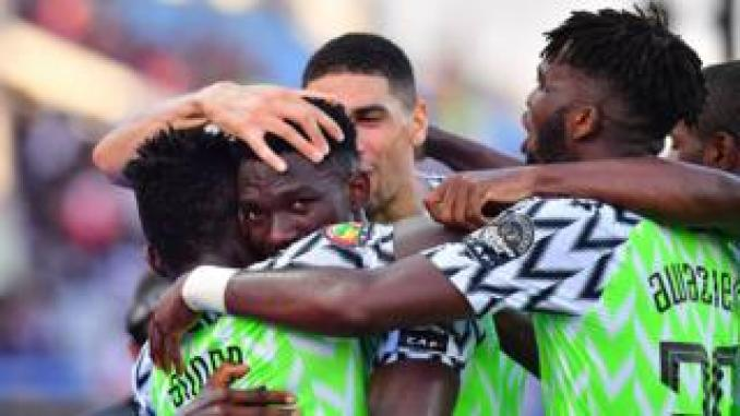 Nigeria's defender Kenneth Omeruo (2nd-L) celebrates his goal during the 2019 Africa Cup of Nations (CAN) football match between Nigeria and Guinea at the Alexandria Stadium on June 26 , 2019.