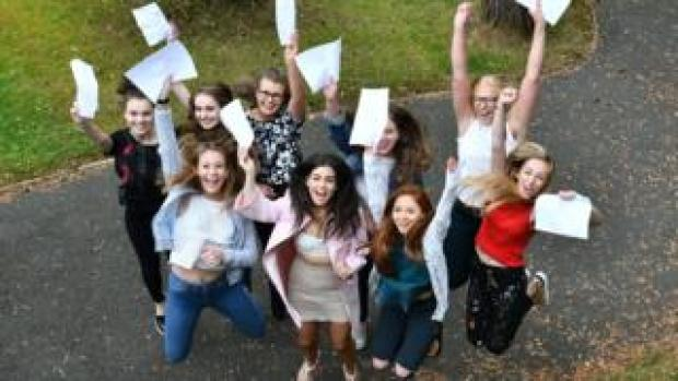 Students from Victoria College in Belfast celebrate their results last year