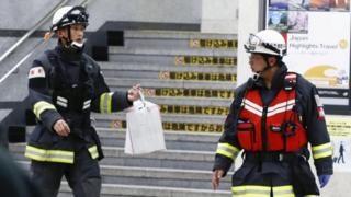 Rescue workers at Odawara station after a Japanese Shinkansen bullet train made an emergency stop on its way from Tokyo to the western city of Osaka due to a man holding an edged tool attacked passengers, Japan, 9 June 2018