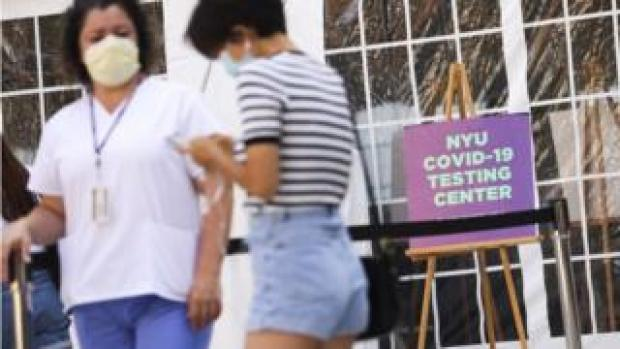 Medical personnel direct students arriving to a Covid-19 testing tent set up at New York University in New York City